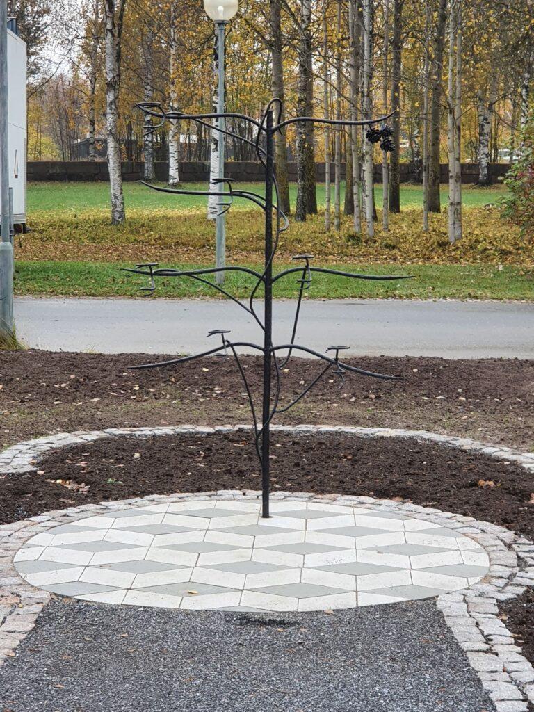 Vasbärare och ljusbärare på kyrkogård